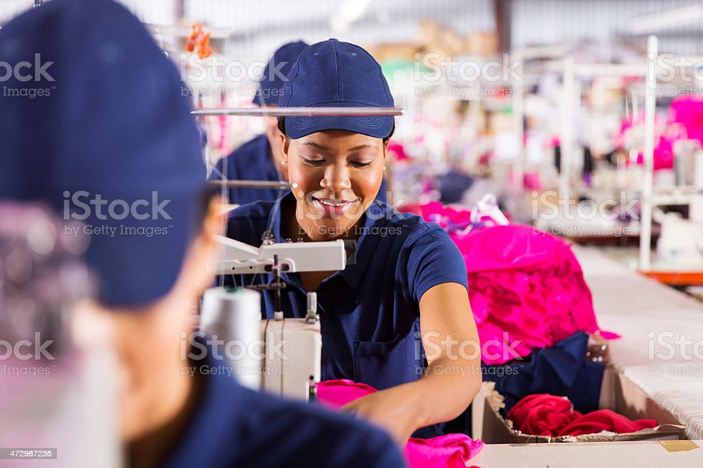 textile factory workers on production line stock photo