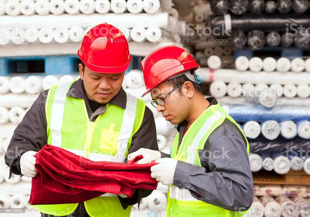 Textile factory workers stock photo