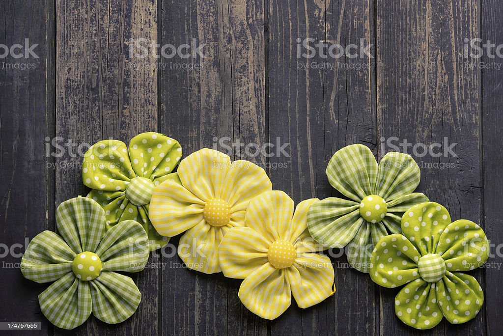 Textile Flowers on Rustic Wood royalty-free stock photo