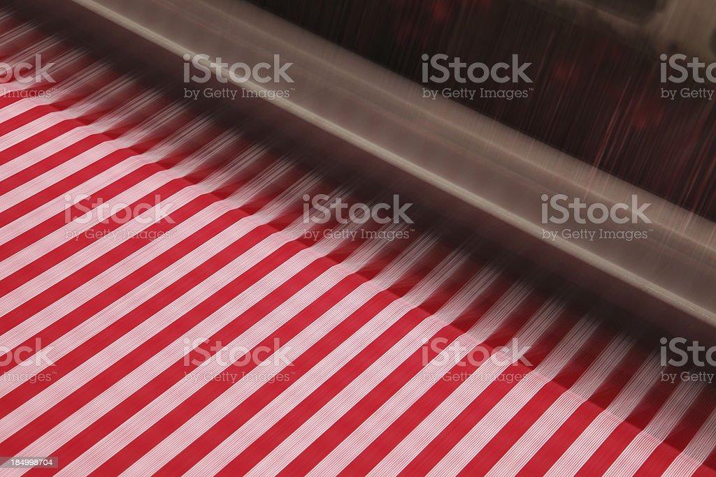 Textile Industry - Weaving Crisscross Pattern on Fabric stock photo