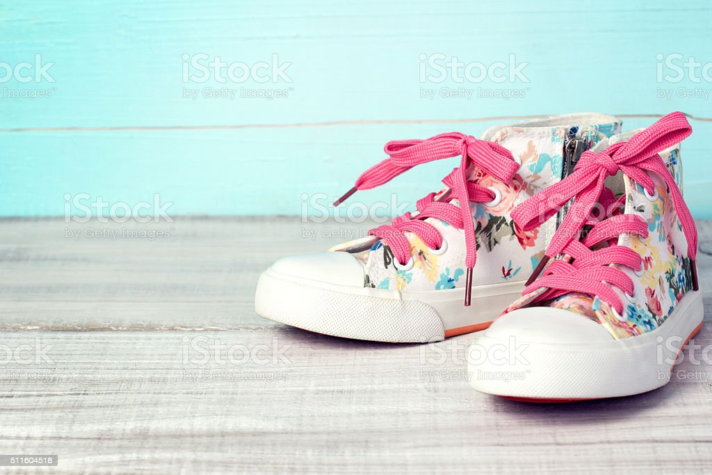 Textile lace sneakers shoes background empty space. stock photo