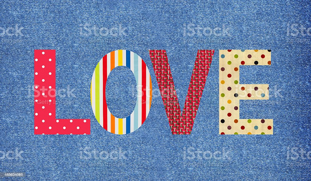 Textile letter love over jeans background stock photo