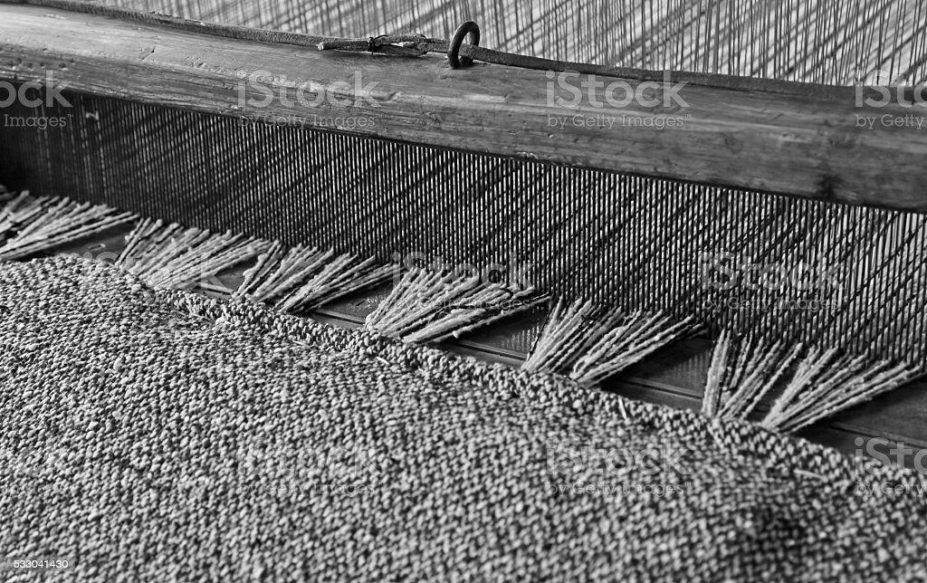 textile loom of wood with black and white colors stock photo
