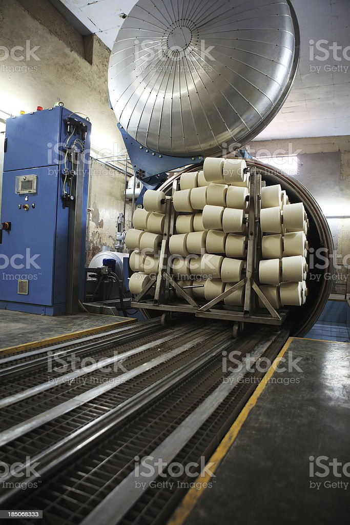 Textile Mill - Cotton Yarn Cones in Steam Autoclaves stock photo