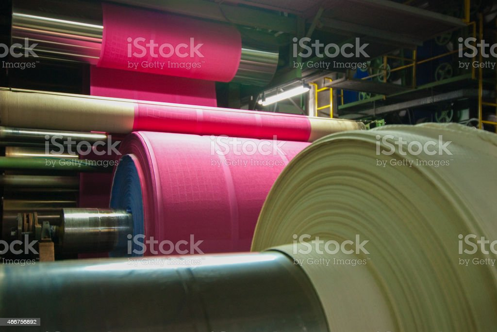 A textile production factory at night stock photo