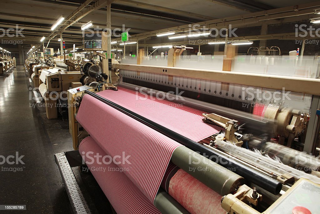 Textile Production - Weaving Cotton Fabric on Airjet Looms stock photo