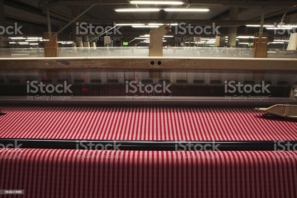 Textile Production - Weaving Crisscross Pattern on Fabric stock photo