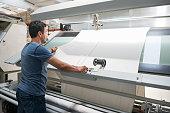 Textile quality controller checking fabrics