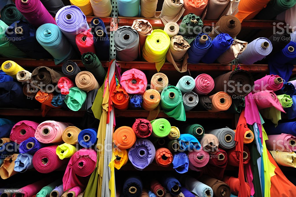 Textile rolls in the Fabric Shop stock photo