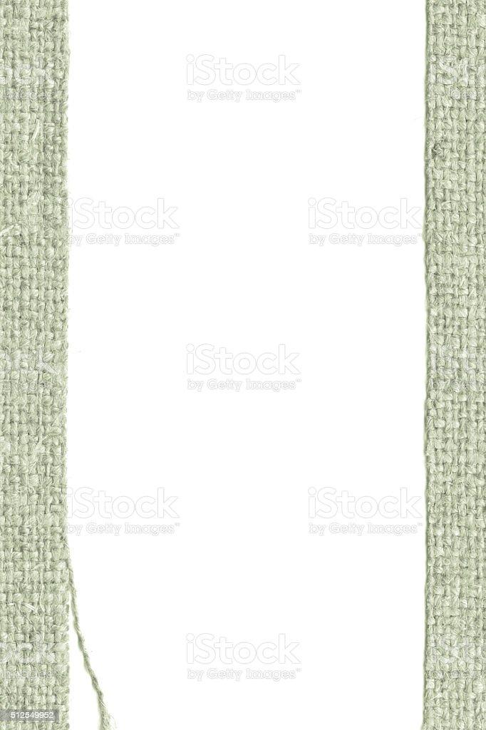 Textile texture, fabric element, khaki canvas, worn material, closeup background stock photo