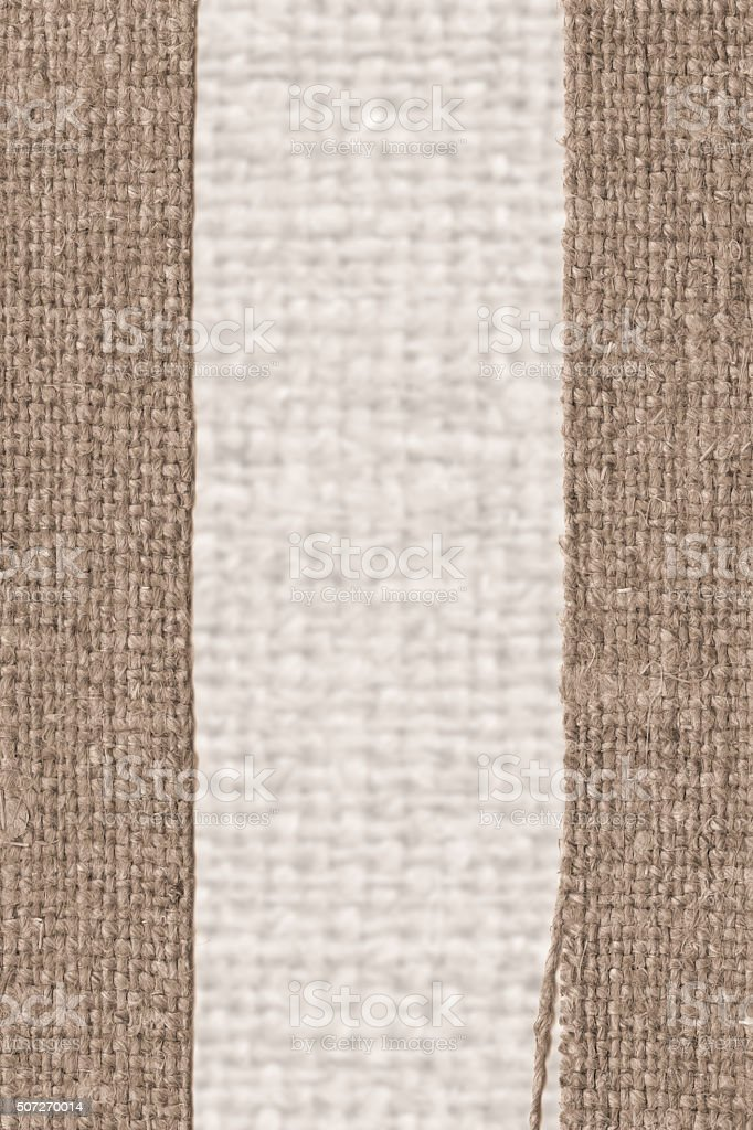 Textile thread, fabric element, mustard canvas material, dirty background stock photo