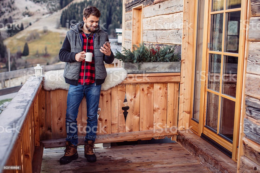 Texting a friend stock photo