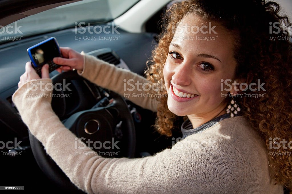 Texting and driving royalty-free stock photo