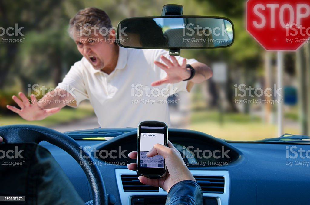 Texting and driving wreck hitting pedestrian stock photo