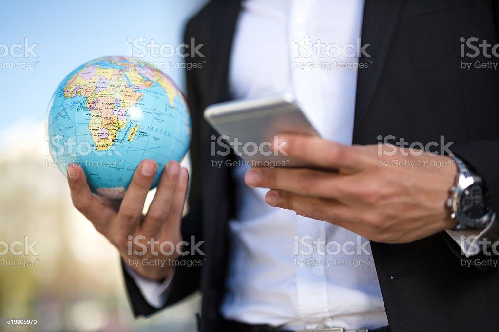 Texting and globe stock photo