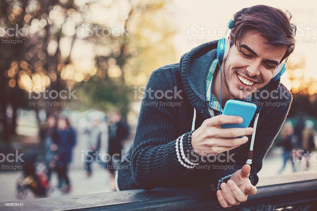 Texting and music stock photo