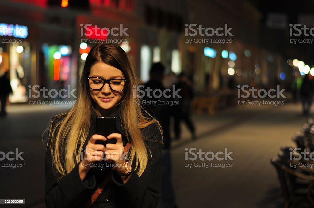 Texting and smiling stock photo