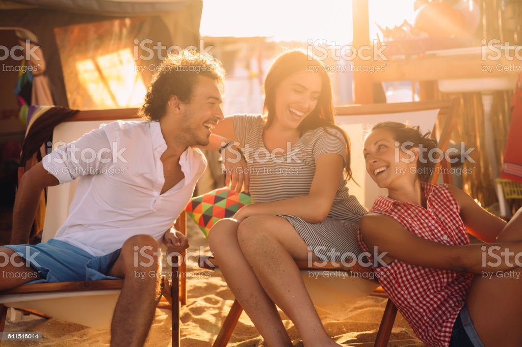 Texting at a beach camp stock photo