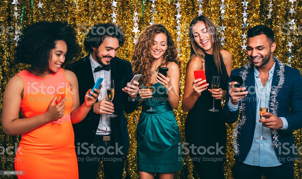 Texting at a party stock photo