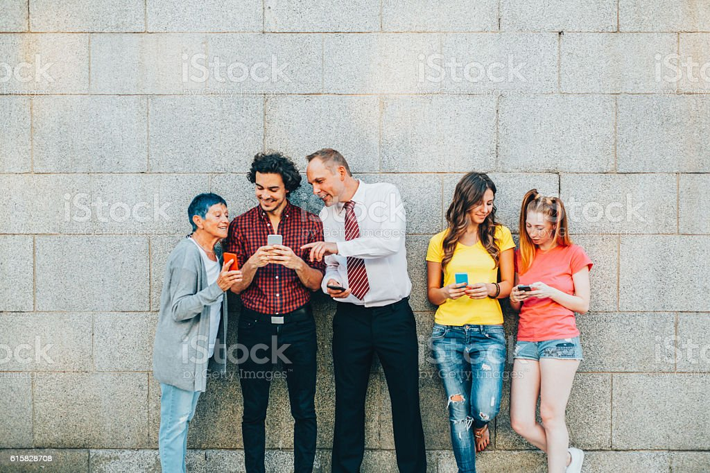 Texting at different ages stock photo