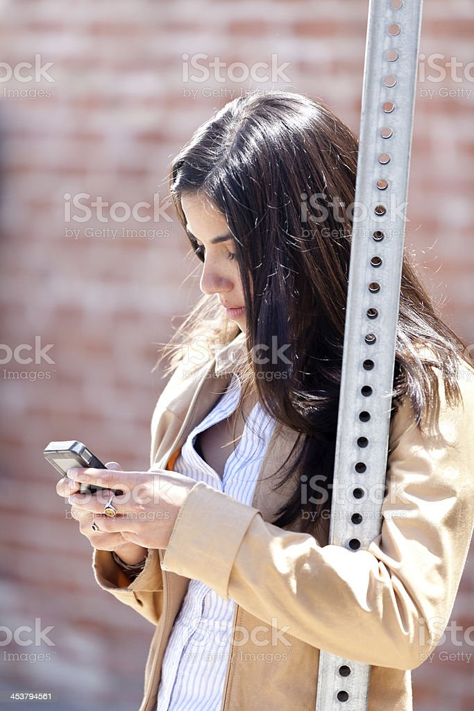Texting at the Bus Stop royalty-free stock photo