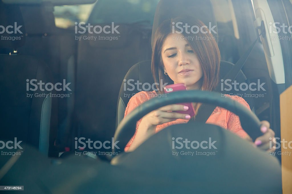 Texting behind the wheel stock photo