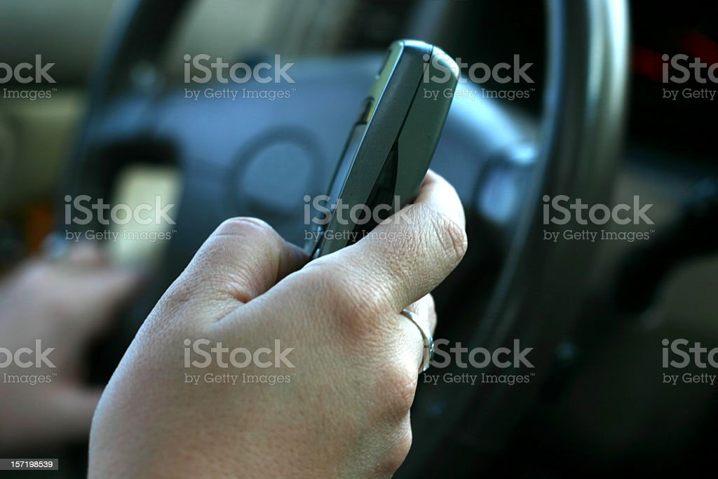 Texting / Dialing and Driving royalty-free stock photo
