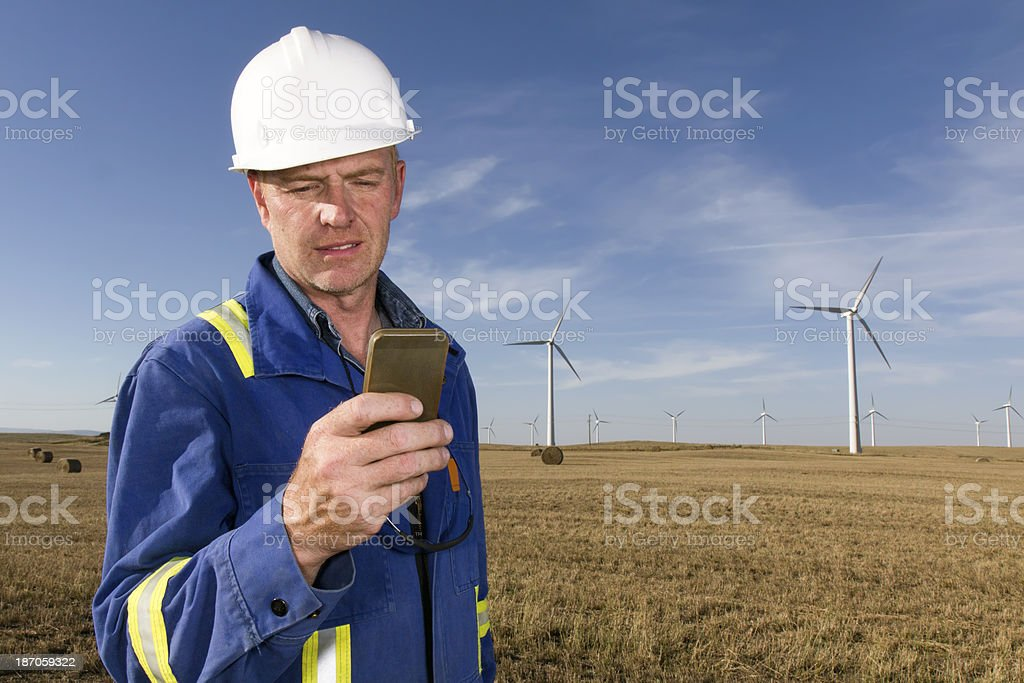 Texting Energy Worker royalty-free stock photo