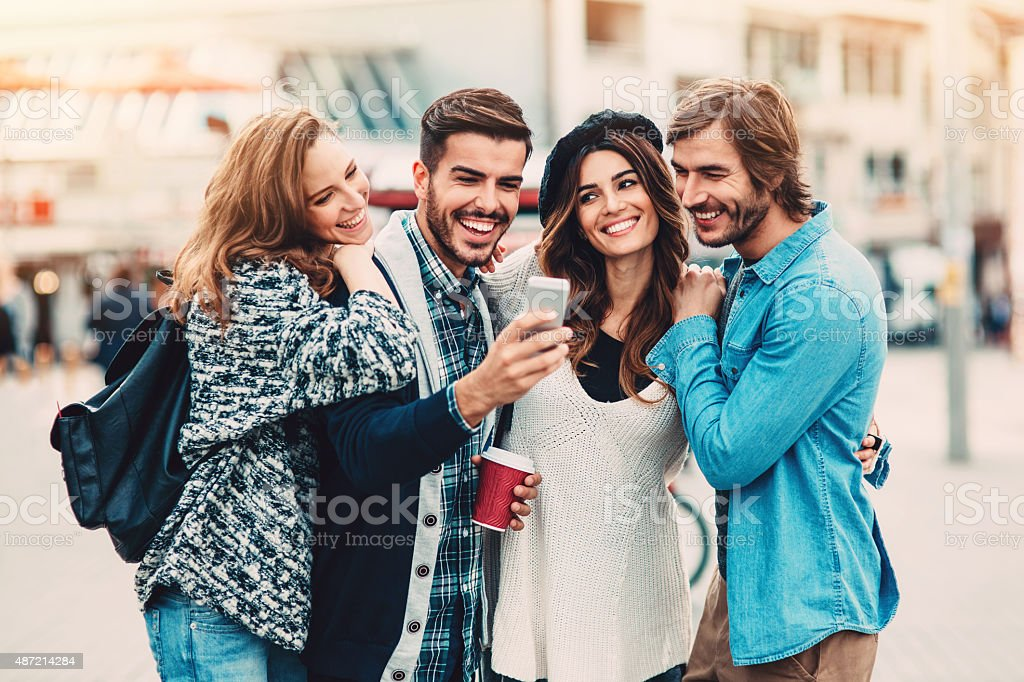 Texting friends stock photo