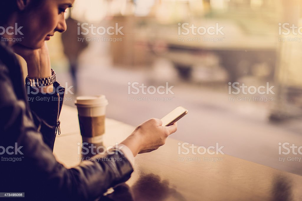 Texting from the cafe stock photo