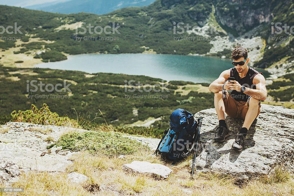 Texting high in the mountain stock photo