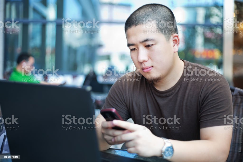 Texting in a cafe royalty-free stock photo