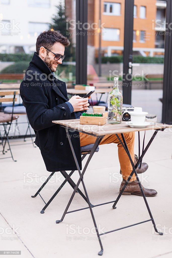 Texting in a cafe stock photo