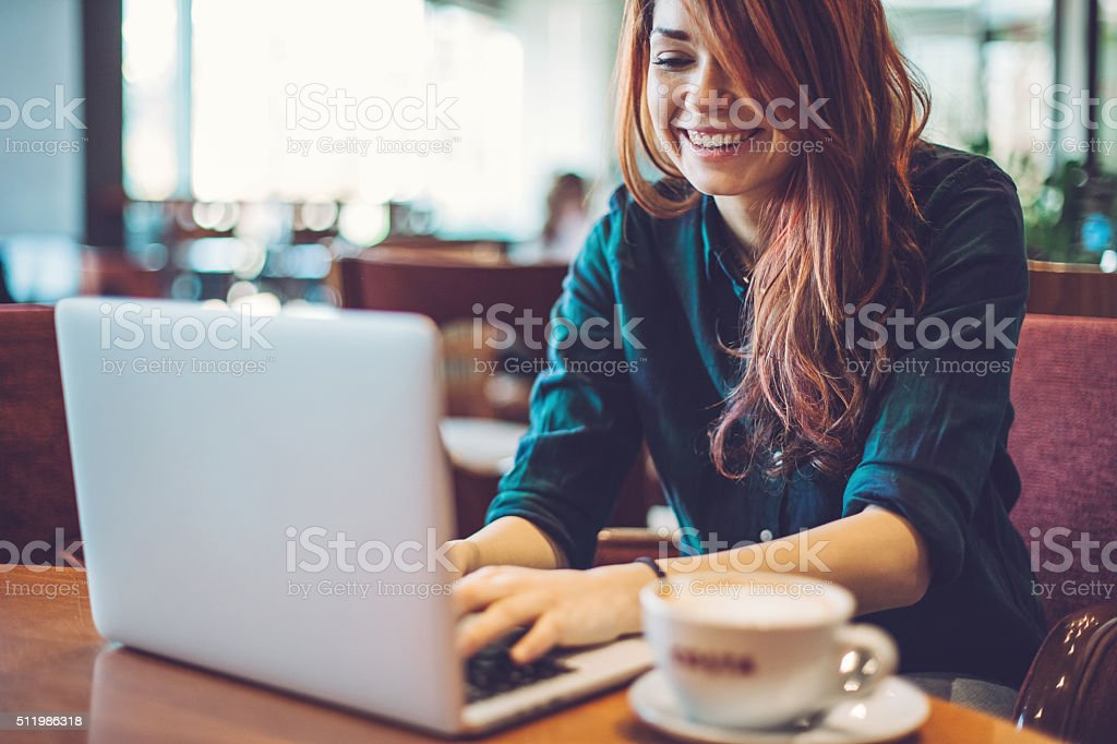 Texting in a coffee shop stock photo