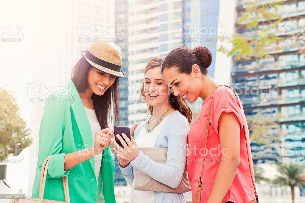 Texting in Dubai Jumeirah Lake Towers. stock photo