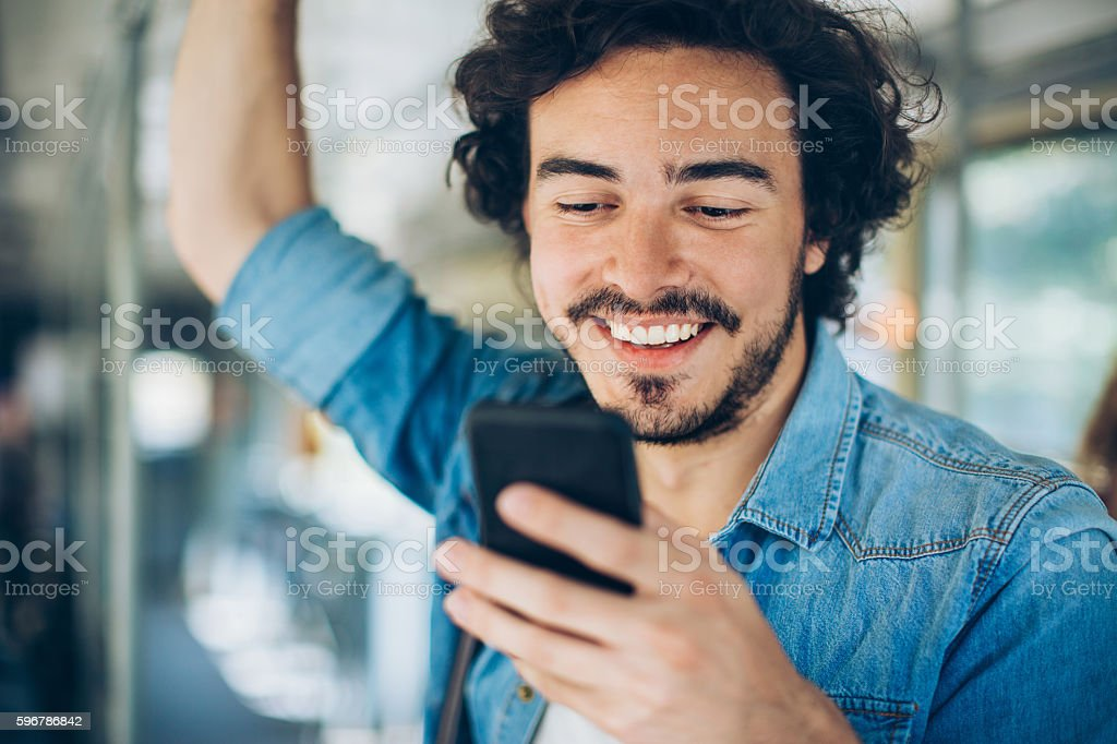 Texting in public transport stock photo