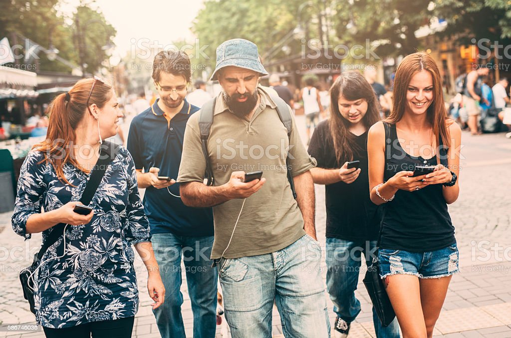 Texting in the city stock photo