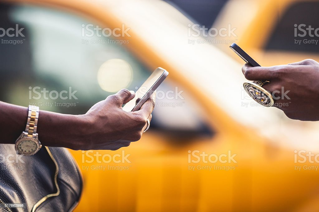 Texting in the city streets stock photo