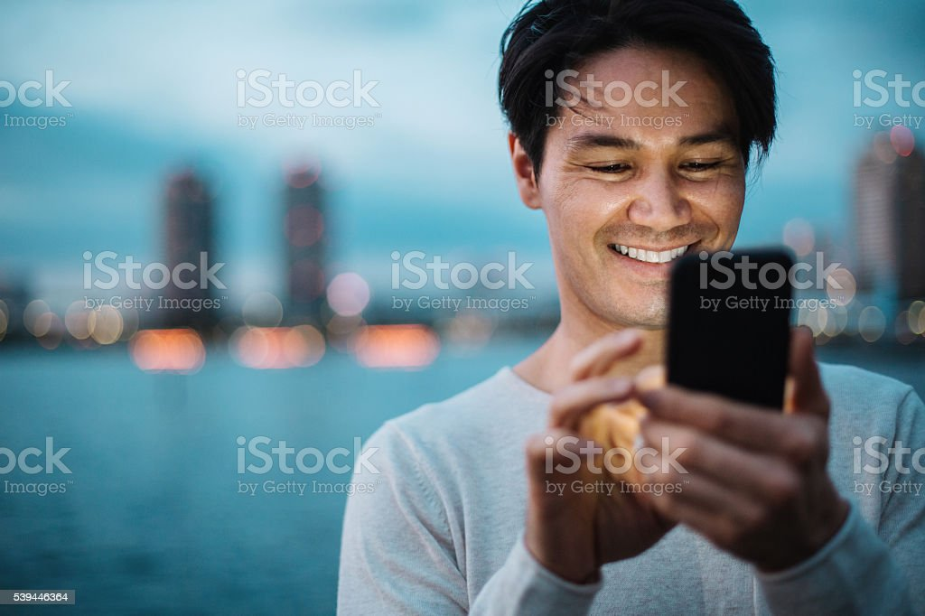 Texting in the evening stock photo