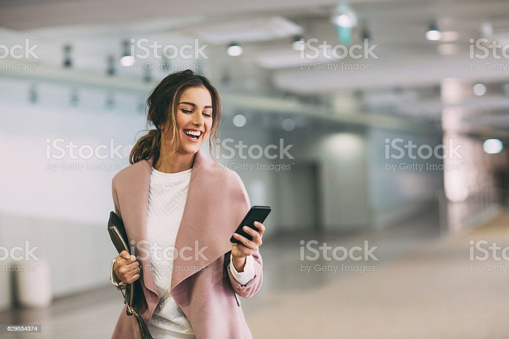 Texting in the subway parking lot stock photo