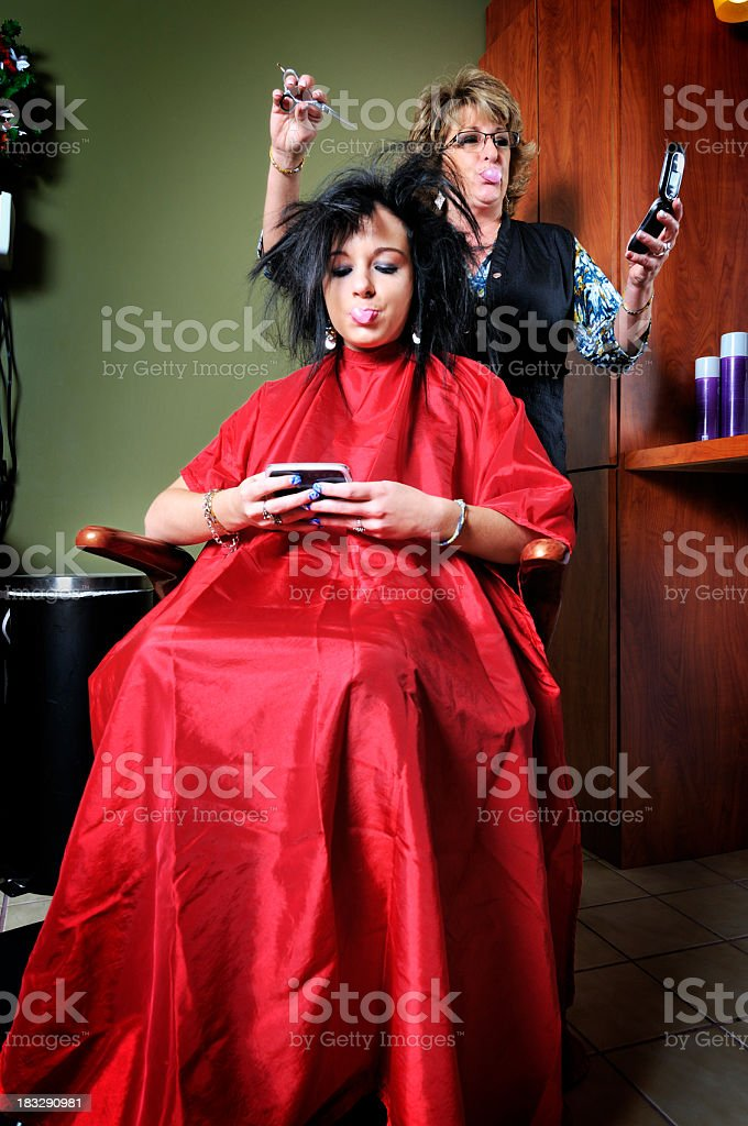 Texting Mania at the Hairdresser's royalty-free stock photo