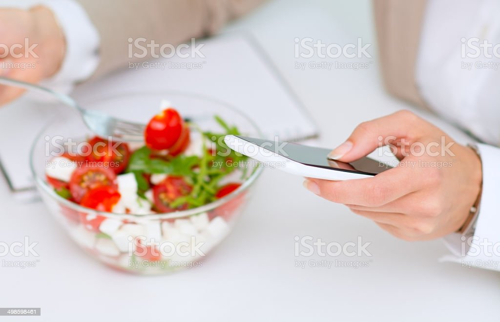 Texting messages on lunch brake stock photo