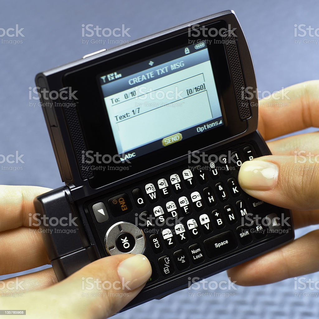Texting on classic style flip cell phone royalty-free stock photo