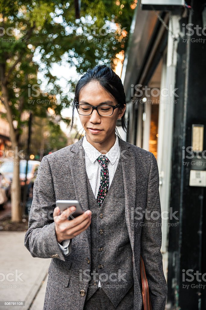 Texting on mobile in Soho New York stock photo