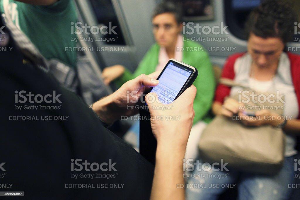 Texting on the Metro - Milan royalty-free stock photo