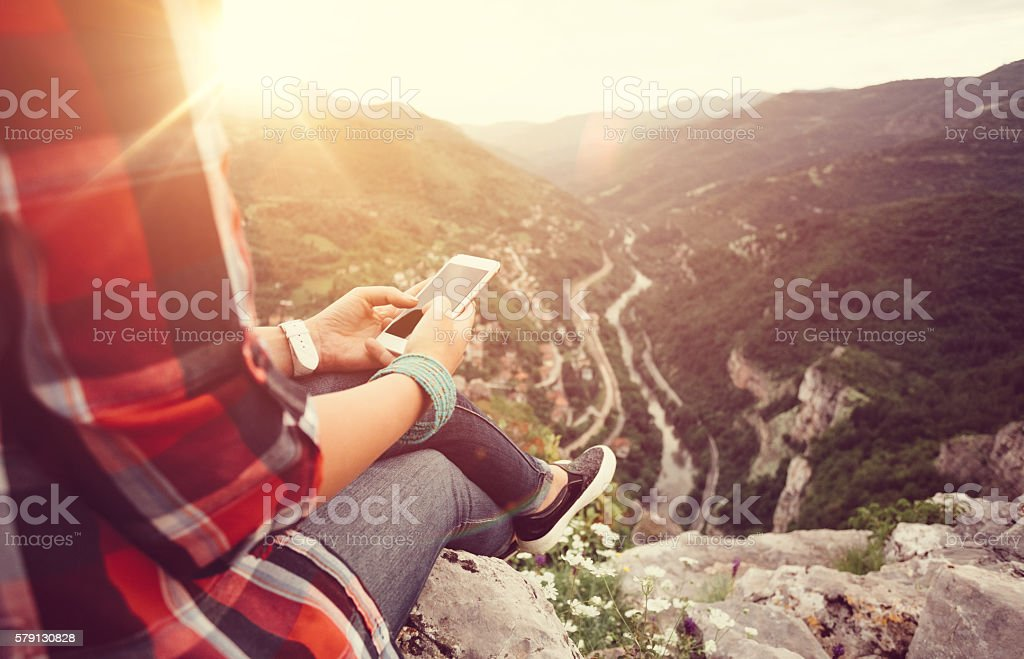 Texting on the mountain top stock photo