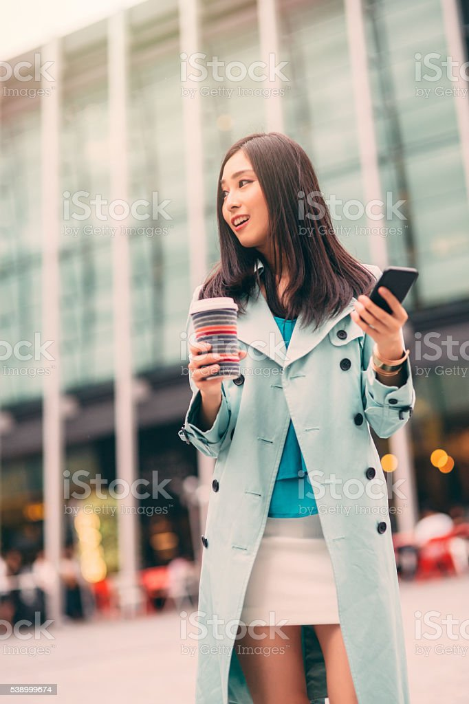 Texting on the phone stock photo