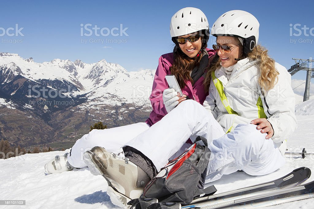 Texting on the Piste royalty-free stock photo
