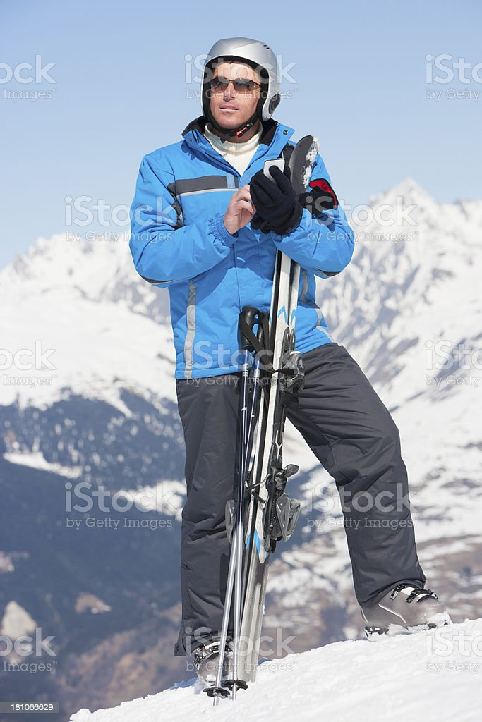 Texting on the Slopes royalty-free stock photo