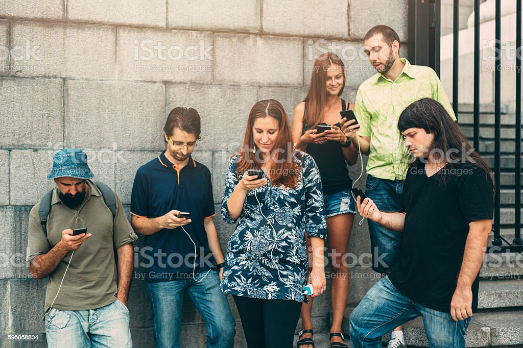 Texting on the street stock photo